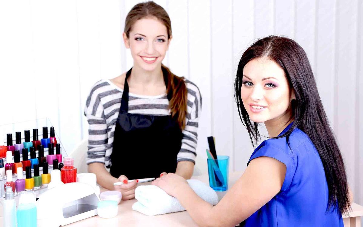 Beautiful girl Идея для бизнеса: Салон красоты на домуmanicurist doing manicure for woman in beauty
